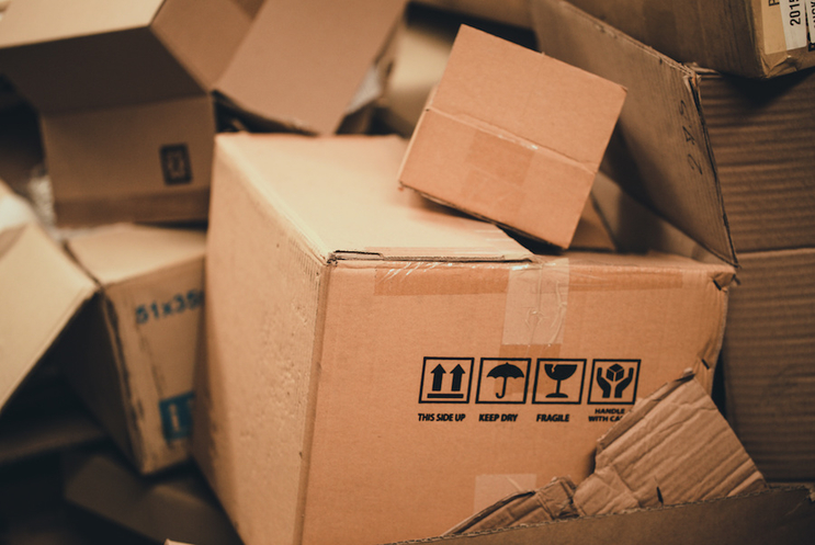 What should I do with my boxes after I have unpacked and settled?
